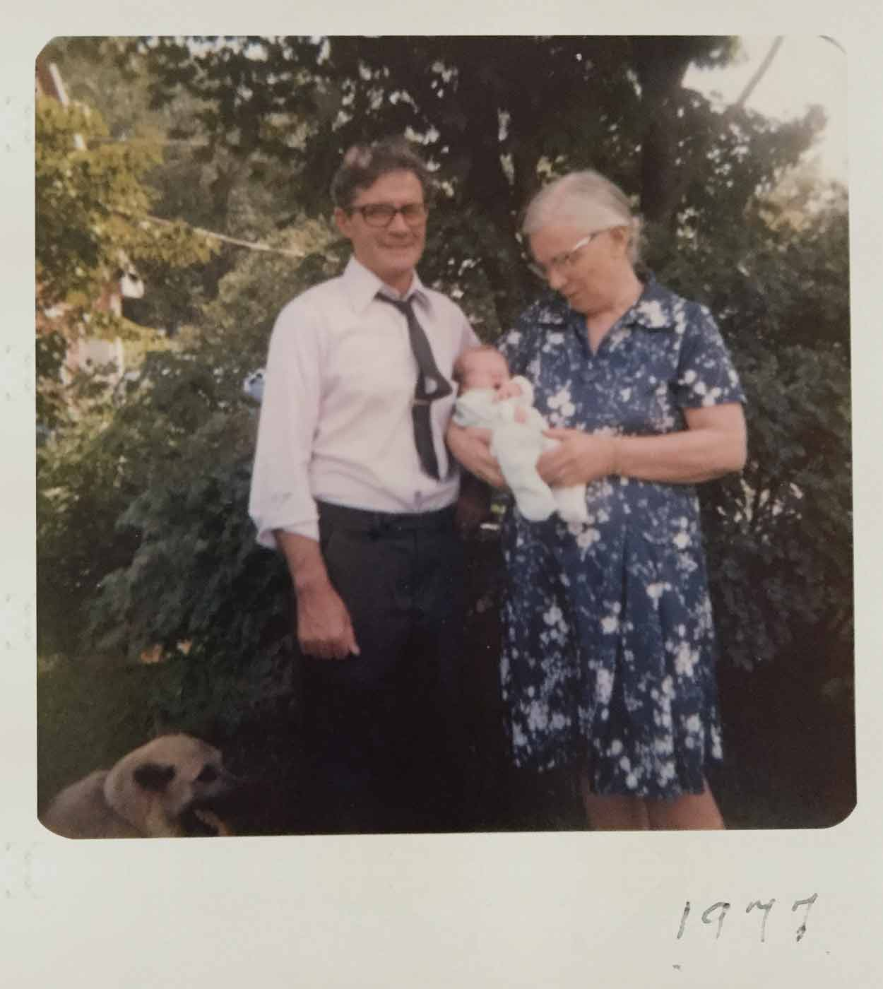 A photo of me, my Grandma, my Grandpa, and their dog, a German Shepherd. I'm the baby in my Grandma's arms.