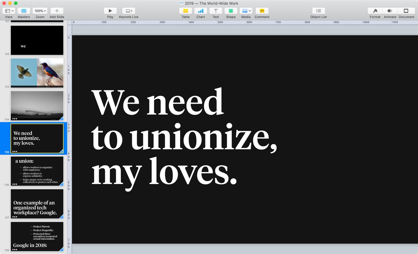 "Slide in a Keynote presentation that reads ""We need to unionize, my loves,"" set in a large white serif typeface against a black background."